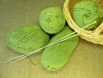 Green yarn and needle Stock Photography