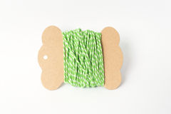 Green yarn thread roll on paper Royalty Free Stock Image