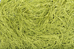 Green yarns chaotic background Royalty Free Stock Photos