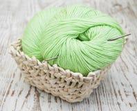 Green yarns and crotchet hook Royalty Free Stock Image