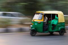 Green and Yellow 3 Wheeled Vehicle Royalty Free Stock Photos