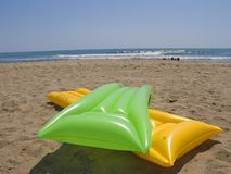 green and yellow air mattresses stock photography