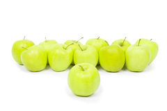 Green and yellow apples on a white baclground Stock Images