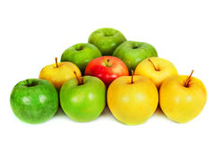Green and yellow apples  on the white in the form of a triangle billiard Stock Photos