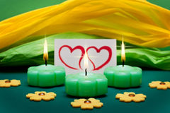 Green-yellow background with candles and hearts Stock Photo