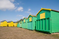 Green and yellow beach huts Stock Photography