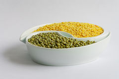 Green and yellow beans in ceramics bowl. Different types of Multicolored beans in white ceramics bowl Stock Image