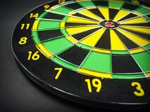 Green Yellow and Black Dartboard Stock Photo