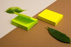Green and yellow blocks of sticky paper on a delimited background. Royalty Free Stock Image