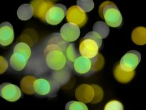 Green and yellow blurred lights night city abstract royalty free stock photography