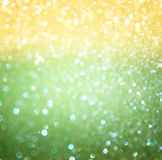 Green and yellow bokeh lights. concept for brazilian flag colors. Stock Photos