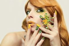 Green yellow bright fashion makeup and manicure . stock photography