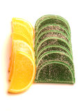 Green and Yellow Candy. Candy fruit slices over white Royalty Free Stock Photo