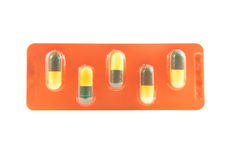 Green and yellow capsule in blister pack Stock Images