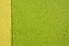 Green and yellow cement wall Stock Photography