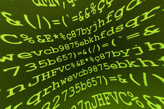 Green and yellow characters. A background of green and yellow characters on a computer Royalty Free Stock Photos
