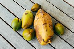Green and yellow coconuts. On a wooden background Stock Photo
