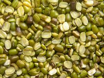 Green and yellow color dry split Mung dal beans.  stock photo