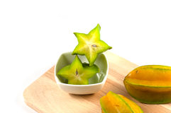 Green and yellow color of starfruit on white background Royalty Free Stock Photo