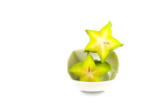 Green and yellow color of starfruit on white background Stock Images