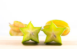 Green and yellow color of starfruit on white background Royalty Free Stock Photography
