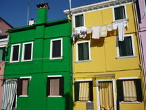 Green yellow colorful building in Burano Italy. Cloth hanging colorful house italy venice royalty free stock image
