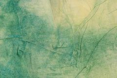 Green and yellow creased painted textile background. Green and yellow  color painted textile background stock photography