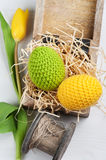 Green yellow crocheted easter eggs Stock Images