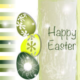 Green and yellow Easter card. With original eggs and stripes Stock Photos