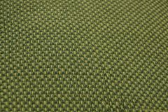 Green yellow fabric texture with a pattern. Green yellow fabric background with pattern Royalty Free Stock Photos