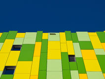 Green and yellow facade. stock images