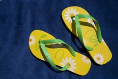 Green and yellow flip-flops. Summer and beach concepts Stock Image