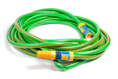 Green and yellow garden water hose Stock Images