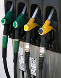 Green and yellow gas  pump rack Royalty Free Stock Photography