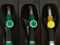 Green and yellow gas  pump rack Stock Photos