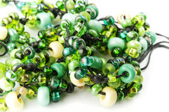 Green and yellow glass. Isolated string of transparent green and yellow glass beads Royalty Free Stock Photography
