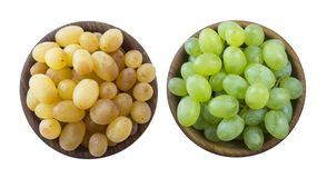 Green and yellow grapes Kishmish. Top view. Grapes in a wooden bowl isolated on white background. Vegetarian or healthy eating. To royalty free stock photos