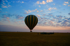 hot air balloon flying over the savannah Royalty Free Stock Images