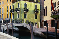 Green and yellow houses in Venice Royalty Free Stock Image
