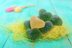 Green and yellow jelly candy heart shaped sugar decoration on a bright spring background. Royalty Free Stock Image