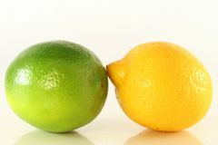 Green and yellow lemon Stock Images