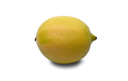 Green yellow lemon isolated on white background. Whole lemon with shadow, clipping path included. Texture with pores and protrusions Stock Image