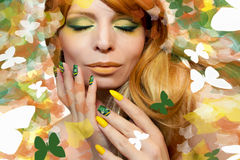Green yellow makeup and manicure. royalty free stock photo