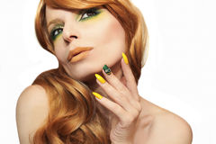 Green yellow makeup and manicure . Royalty Free Stock Photos