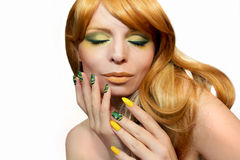Green yellow makeup and manicure . Royalty Free Stock Image