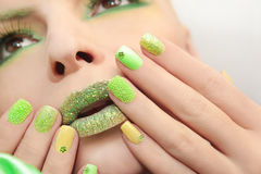 Green yellow manicure . Royalty Free Stock Photography