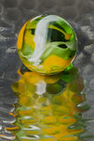 Green & Yellow Marble Reflection Stock Photography