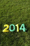Green and Yellow 2014 Message on Grass Background Royalty Free Stock Images