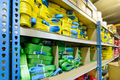 Green, yellow nylon soft lifting slings stacked in piles. Stock Photography