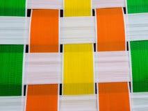Green yellow orange white geometric weave pattern vintage chair 1960 squares. Vintage geometric square pattern green orange yellow white waterproof old chair Stock Photography